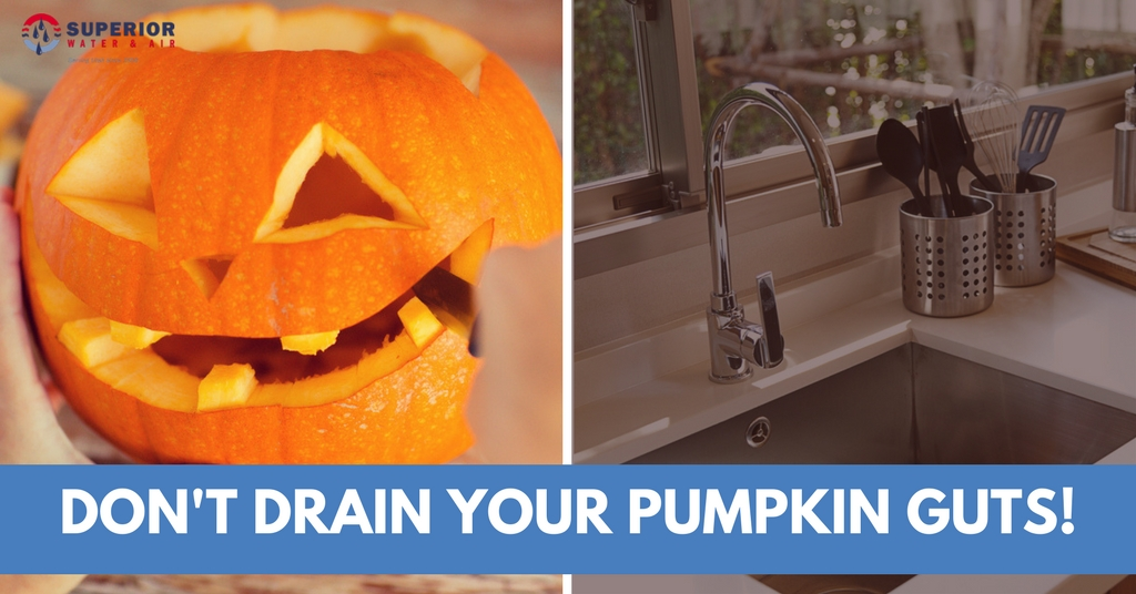 A carved pumpkin and a clean kitchen sink side-by-side.