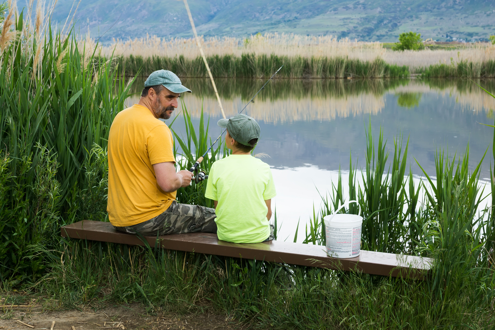 Father and son fishing in Utah